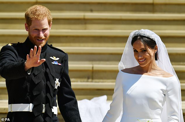 Prince Harry and Meghan are pictured after their wedding at Windsor Castle in May 2018