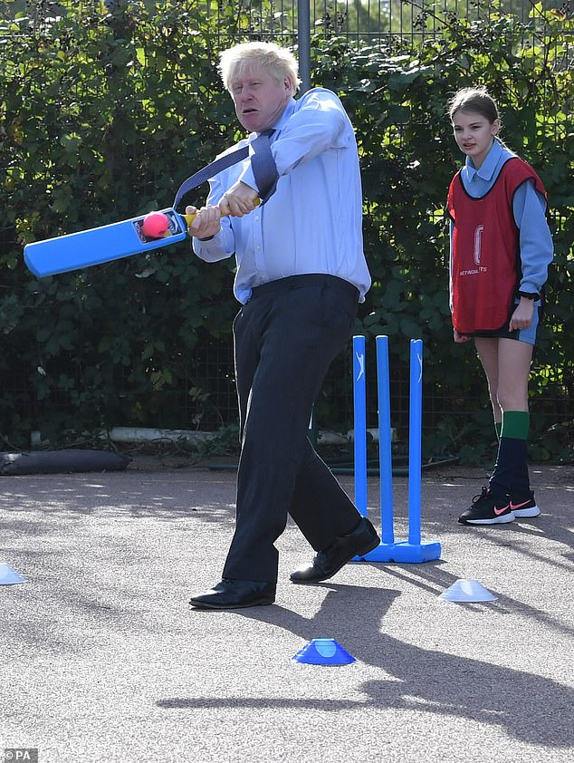 Boris Johnson (pictured on a visit to a school in Ruislip today) is struggling to quell growing fury from his own MPs over Covid restrictions and the lack of parliamentary scrutiny