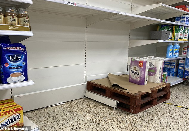 It has been reported supermarkets are boosting security and have doubled number of delivery slots amid fears Covid-19 panic buying could return. Pictured: Tesco in south east London