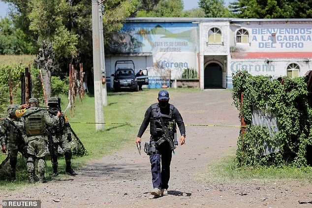 Mexican police and army stand guard outside of the Guanajuato bar in where the drug's hit took place