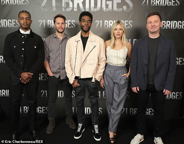 The line-up: From left to right, Stephan James, Taylor Kitsch, Chadwick, Sienna and director Brian (pictured November 2019)