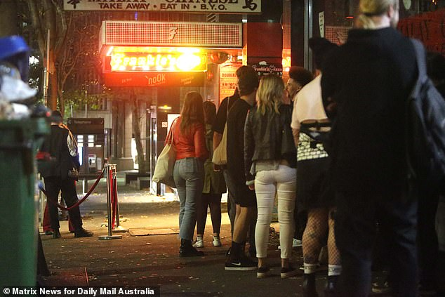 Hospitality industry leaders estimate up to 15,000 new jobs could be created if more customers are allowed inside venues (pictured patrons line up outside a Sydney club)