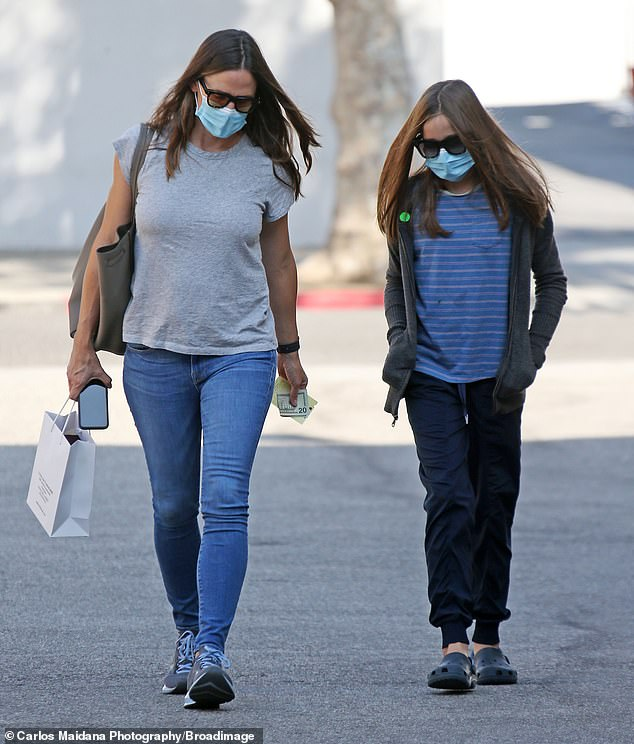 Outing: Jennifer Garner, 48, was spotted out with lookalike daughter Seraphina, 11, on Monday as the pair ran some errands together in Beverly Hills