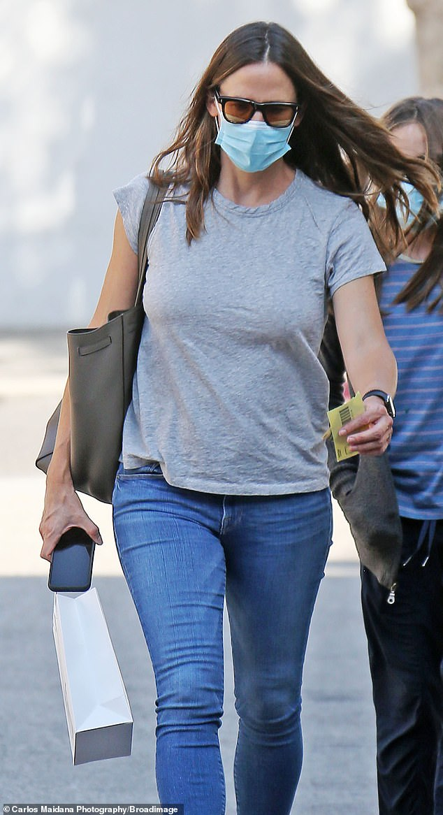 Looking good: Garner showed off her workout-honed figure in a gray t-shirt and blue skinny jeans. Her long hair was loose and she sported black-framed sunglasses