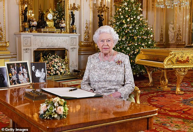 The Queen is said to be 'furious' after Royal Household staff revolted against a plan for them to stay in a Covid bubble at Sandringham over Christmas. Pictured: Her Majesty pre-recording her annual Christmas Day message at Buckingham Palace before heading to Norfolk in 2018