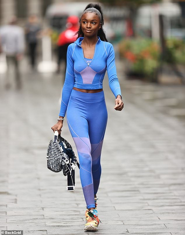 Top of the crops:The supermodel, 27, displayed her svelte physique in a form-fitting sporty blue crop top as she arrived at the Capital Xtra offices in Leicester Square