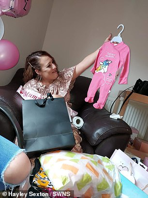"""Recalling the moment she discovered she was actually birthing a little boy, Hayley (pictured at her baby shower) explained: 'When the midwife said """"he's here"""" I was like """"what do you mean 'he'?"""""""