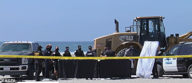 A woman may have been asleep when she was crushed by a Caterpillar tractor at around 10am near Oceanside Harbor
