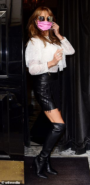 Legs for days: Former footballer Jason Cundy's ex-wife amped up the glamour by teaming her top with a leather mini-skirt and heeled thigh-high boots