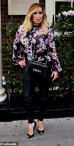 Fashion savvy: The wife of media mogul Richard Desmond stunned in a floral print shirt, PVC trousers and pointed heels