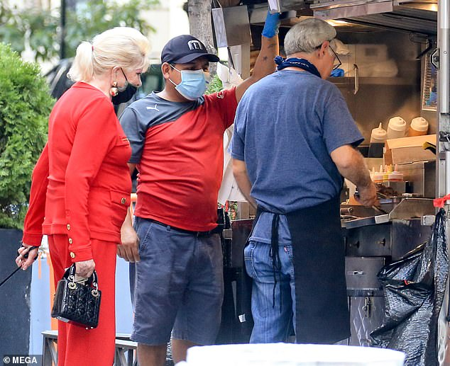 She's a regular! Ivana stopped by her favorite street vendor to pick up some street meat. The socialite regularly eats hot dogs and sausages from a food cart at 64th and Madison