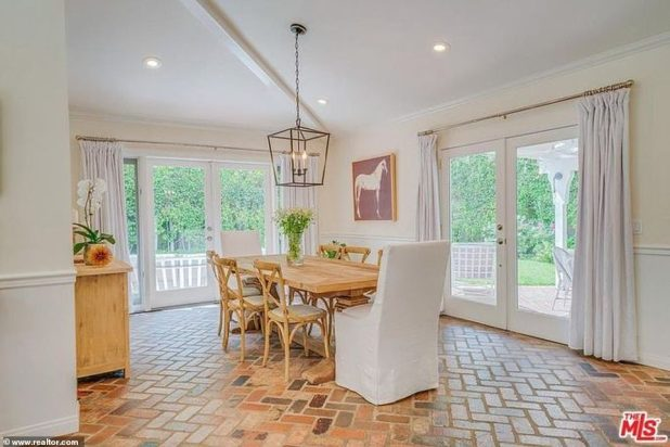 Let's Eat: The dining room is out of the kitchen and offers glass doors on two walls with a large pendant chandelier.  Easily enough space for a table for eight