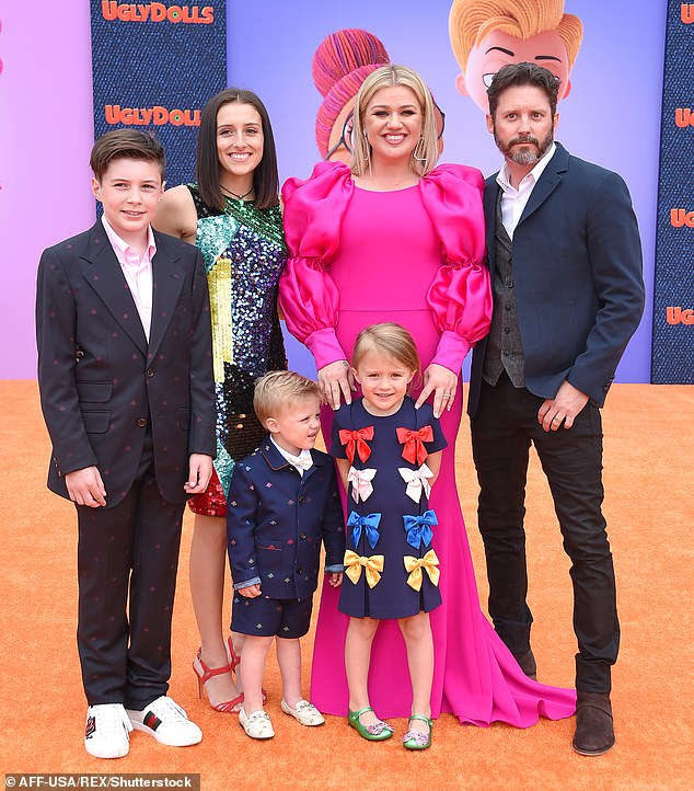 In court:The star also asked for spousal support and for the former couple's prenuptial agreement to be implemented (Pictured in 2019 with Brandon, their two children and his children from a previous relationship,Savannah, 18, and Seth, 13)