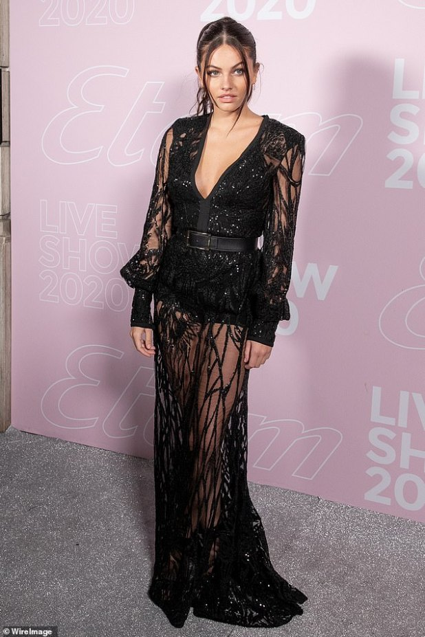 Style: The dress had a stylish necklace that snatched a glimpse of the star's crevice that peaked at her trim waist.