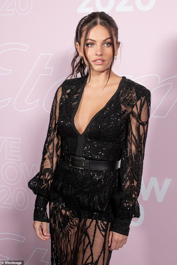 Wow: Beauty, 19, showcased her toned legs in a prim gown, which featured a black bodysuit with a shimmering sequin sheer skirt