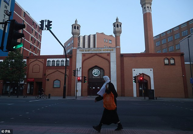 Almost half of Conservative Party members believe Islam is 'generally a threat' to the British way of life, a poll found (file photo of the East London Mosque)