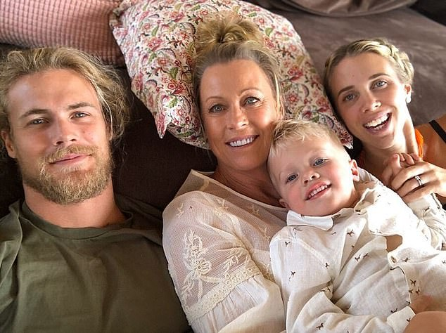 Family: Lisa is pictured with her son Jett (left), daughterMorgan (right) and her grandsonFlynn