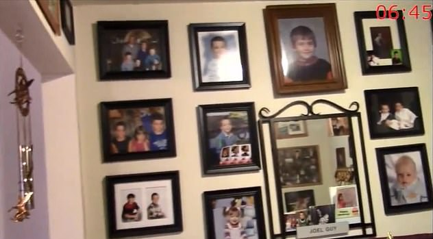 Family and baby pictures of Joel and Lisa's children are seen adorning a wall inside the family's home