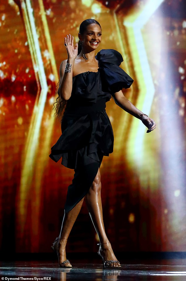 Glittering: The singer put on a leggy display in the stylish gown, which she teamed with a pair of glitzy barely-there heels