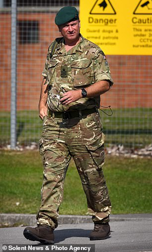 Veteran Staff Sergeant Robert Maddock, 44, pictured leaving Bulford Military Court, got into a 'physical alteration' with a Lieutenant