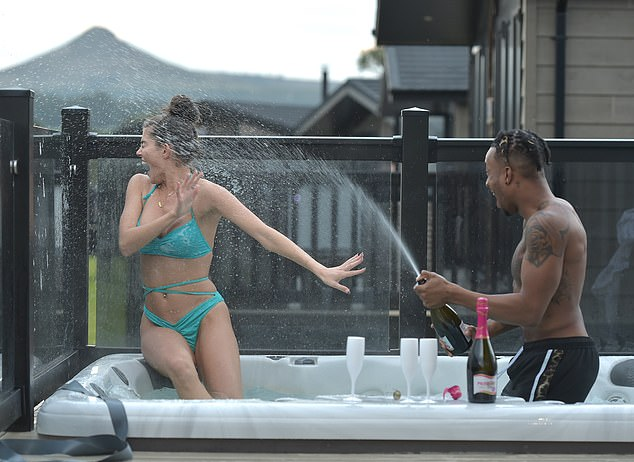 Watch out: Biggs appeared to be having a great time soaking his girlfriend