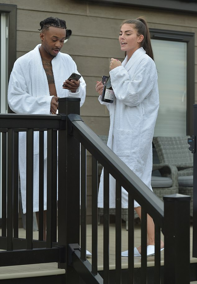 Prosecco o'clock! They stayed wrapped up in robes while receiving their booze delivery