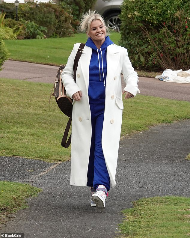 Outfit:Kerry cut a casual figure for the outing, donning a blue hoodie with matching tracksuit bottoms and a pair of multicoloured trainers