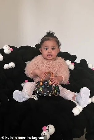 Kylie said in the caption: 'Dad dropped a new chair for Stormi.  And omg that girl threw the bag over her shoulder, I can't