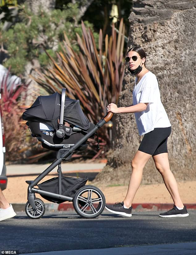 Mom mode: The 34-year-old actress sported shorts and a T-shirt as she caught up on her steps and pushed a stroller around the beach community