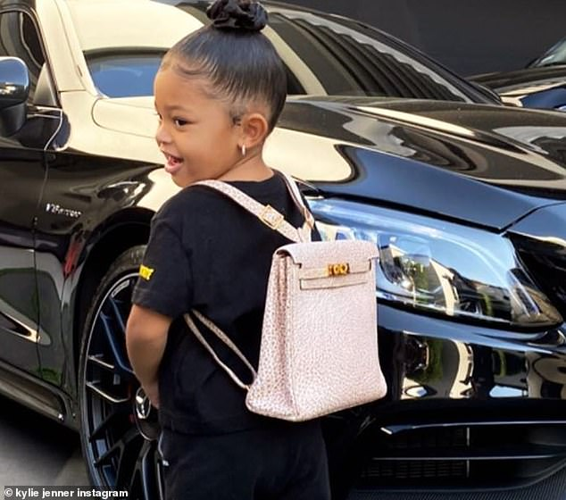 A closer look: the toddler proudly rocked the pink textured Hermes bag, which featured gold hardware