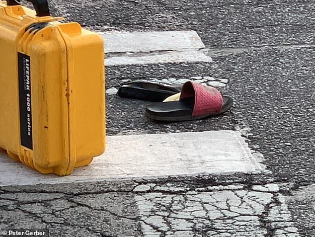 The seven-year-old's shoes remained on the street as the accident was investigated