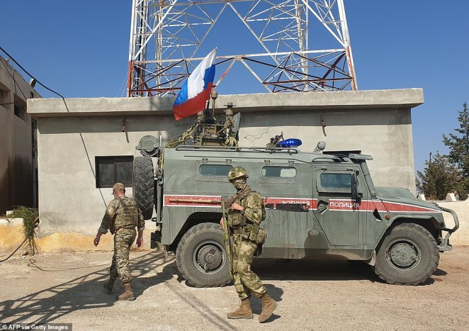 Russian soldiers and their military police vehicle carry out a patrol in Syria last year as Moscow extends its influence in the Middle East