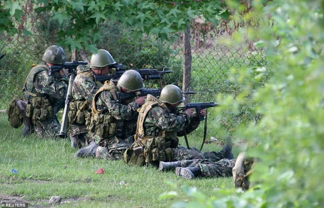 Analysts traced the revamp of Russia's military back to a near-disaster in a war with Georgia in 2008 (Russian troops are pictured securing a settlement during that conflict)