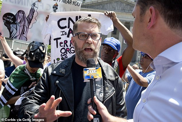 The Proud Boys was originally started as a joke by Vice Media co-founder Gavin McInnes (pictured) in 2016, naming it after the Aladdin song, 'Proud of Your Boy'