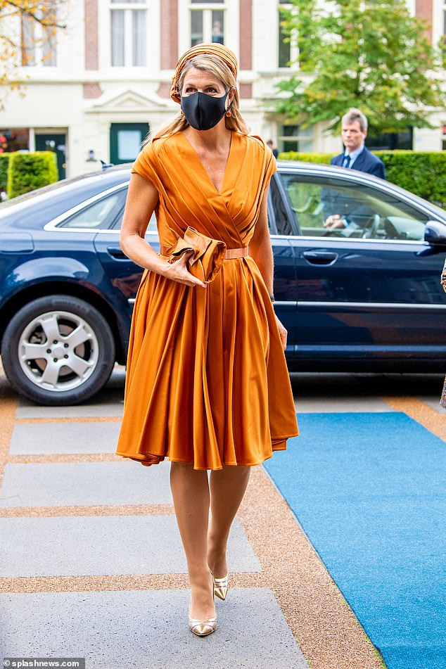 Queen Maxima of the Netherlands delighted royal fans with two colourful outfits for several engagements in the Hague, today. The Dutch queen, 49, arrived atthe anniversary of the Social and Economic Council congress. The Hague, wearing a vibrant orange pleated dress
