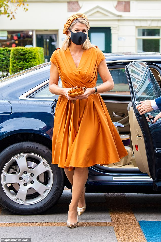 The Queen of the Netherlands looked stylish in the orange get up as she stepped out of her car today