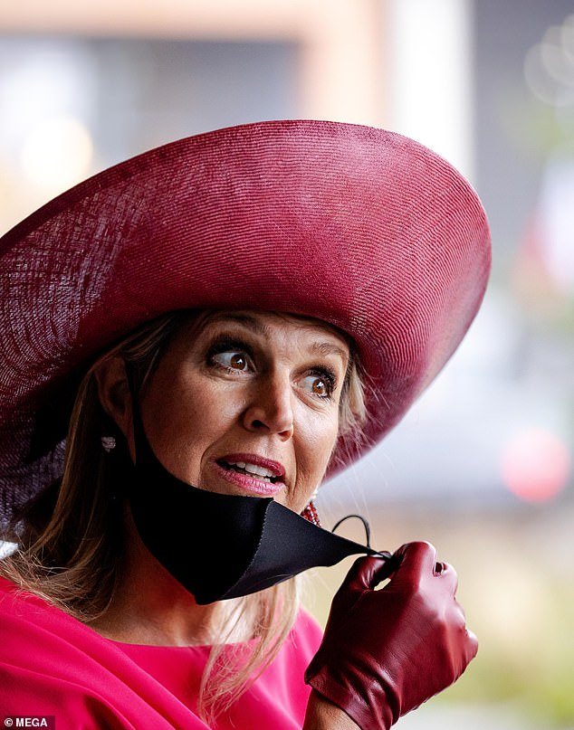 Maxima took off her mask as she spoke to staff after arriving at the Breast Cancer Awareness month event