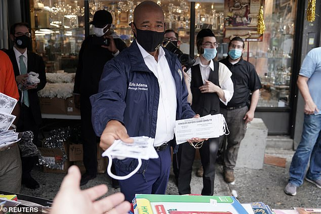 Brooklyn Borough President Eric Adams hands out masks in the Borough Park neighborhood this week after the region, which has a high Orthodox Jewish population, reported a spike in COVID-19 cases