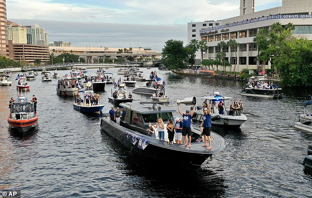 Members of the Tampa Bay Lightning make their way down the Hillsborough River as they are greeted by fans during Wednesday's boat parade