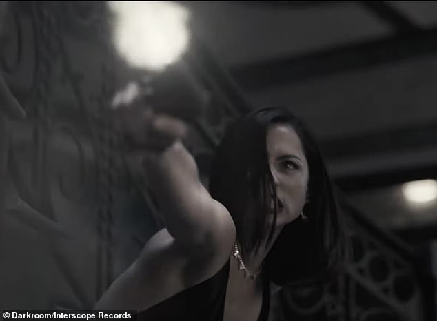Drama: The highly anticipated music video also shows CIA Agent Paloma played by Ana de Armas involved in a dramatic fight while wearing a glamorous ball gown
