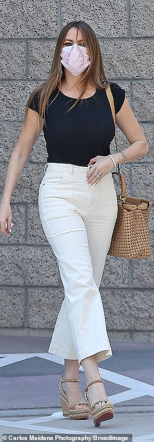 A step in the right direction! The actress made her way around the sunshine in embellished wedges