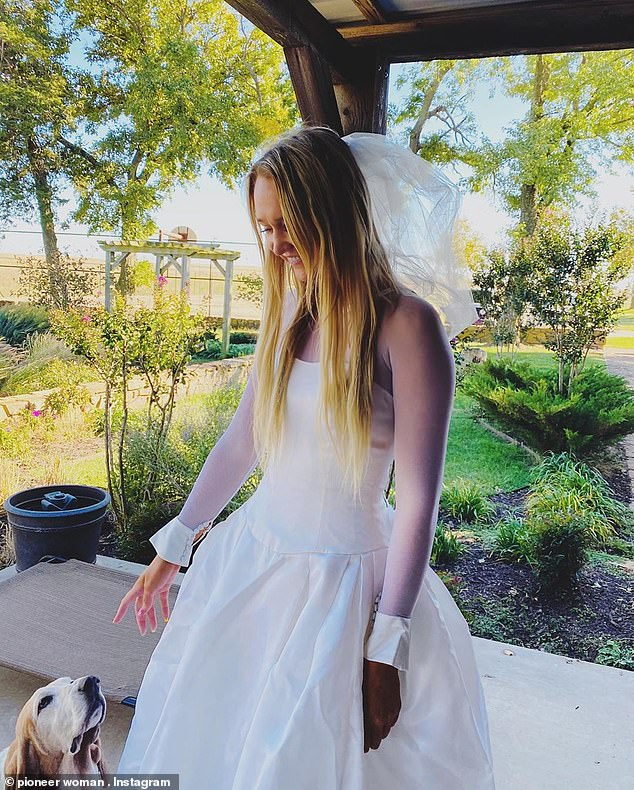 Dress up time!While eldest daughter Alex, 23, was the one who actually got engaged over the summer, the wildly successful cookbook author joked about how younger sister Paige, 20, was happy to play dress up in her caption