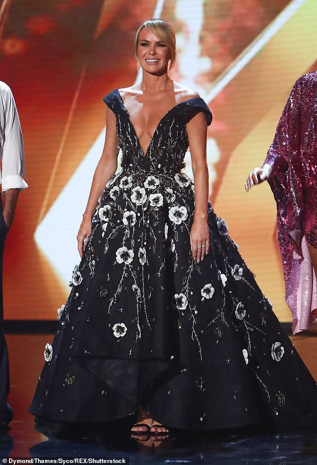 Busty: The TV star showed off her assets in this deep v-neck gown on BGT last year