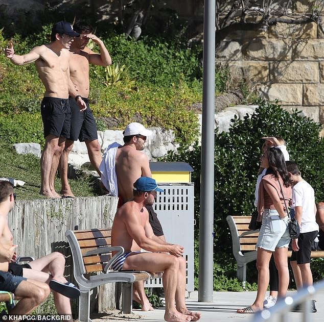 Single and ready to mingle? The girls were spotted talking to a bunch of shirtless guys near the beach and appeared to have a laugh