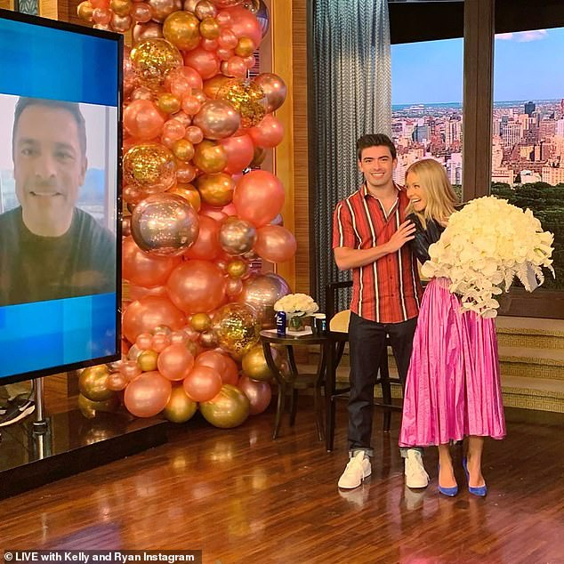 Cheers! On Friday's show, Kelly was surprised with a beautiful bouquet from her oldest son, Michael, while Mark dialed-in on a video call