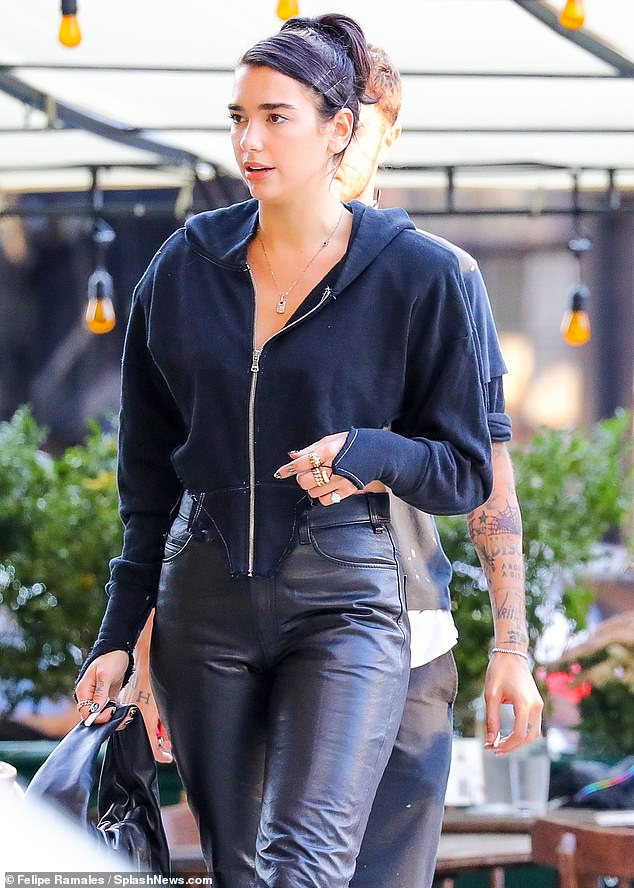 Wow: Don't Start Now hitmaker, 25, looked amazing as she showed off her butt in high waisted leather pants
