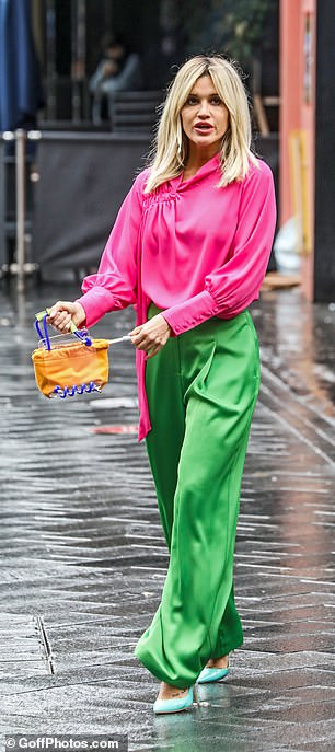Intriguing: The Don't Cha hitmaker stored her essentials in an unusual orange and purple bag