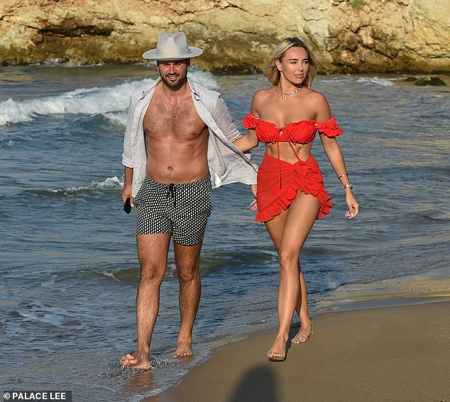 Couple goals:She chose to enhance her pretty features with soft touches of make-up and later added a ruffled sarong to her swimwear