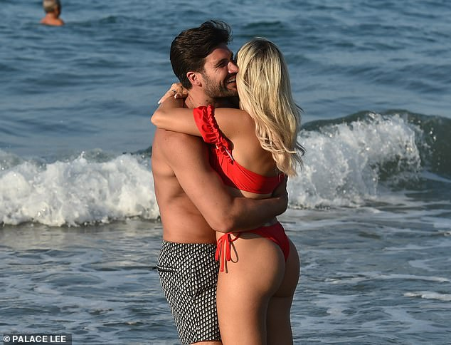 Glam:The reality personality's top was a pretty bardot style, which she teamed with a pair of skimpy matching bottoms to complete her beachwear look