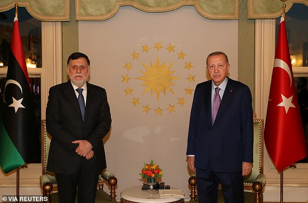 Erdogan's spokesperson (pictured right, with internationally renowned Libyan Prime Minister Fayez al-Sarraj in Istanbul, Turkey, yesterday) said in a tweet that Macron's `` dangerous and provocative vision '' encourages Islamophobia and anti-Muslim populism ''